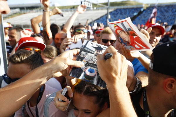Hungaroring, Budapest, Hungary. Thursday 21 July 2016. Fernando Alonso, McLaren signs autographs for his fans. World Copyright: Steven Tee/LAT Photographic ref: Digital Image _H7I0136