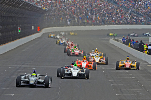26 May, 2013, Indianapolis, Indiana, USA Eventual winner Tony Kanaan (#11) leads Ed Carpenter (#20), Marco Andretti (#25), E. J. Viso (#5) and Carlos Munoz (#26) in the opening laps. ©2013, F. Peirce Williams LAT Photo USA