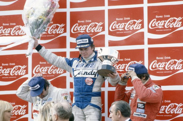 1980 Belgian Grand Prix.Zolder, Belgium. 2-4 May 1980.Didier Pironi (Ligier JS11/15-Ford Cosworth), 1st position on the podium, with Alan Jones (Williams FW07B-Ford Cosworth), 2nd position, and Carlos Reutemann (Williams FW07B-Ford Cosworth), 3rd position.World Copyright: LAT PhotographicRef: 35mm transparency 80BEL07