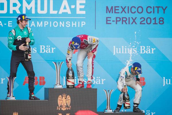 2017/2018 FIA Formula E Championship. Round 5 - Mexico City ePrix. Autodromo Hermanos Rodriguez, Mexico City, Mexico. Saturday 3 March 2018. Daniel Abt (GER), Audi Sport ABT Schaeffler, Audi e-tron FE04, celebrates on the podium after winning the race with Oliver Turvey (GBR), NIO Formula E Team, NextEV NIO Sport 003, and Sébastien Buemi (SUI), Renault e.Dams, Renault Z.E 17. Photo: Zak Mauger/LAT/Formula E ref: Digital Image _54I8995