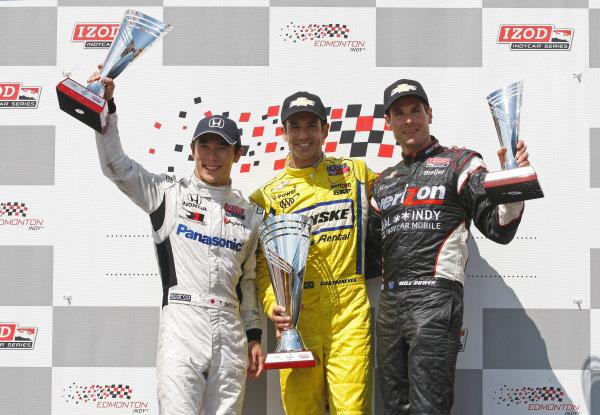 20-22 July, 2012, Edmonton, Alberta CAHelio Castroneves, Takuma Sato and Will Power celebrate on the podium.(c)2012, Phillip AbbottLAT Photo USA