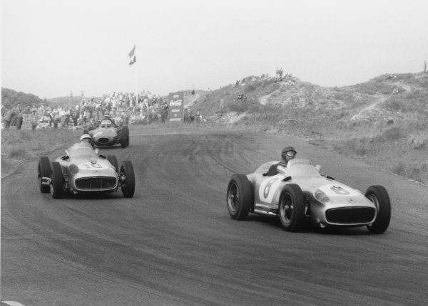 Zandvoort, Holland. 19th June 1955.Juan Manuel Fangio (Mercedes-Benz W196),1st position, leads Stirling Moss (Mercedes-Benz W196), 2nd position, action.World Copyright: LAT Photographic.Ref: 306 - 28.