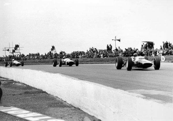1965 British Grand Prix.Silverstone, Great Britain. 10 July 1965.Lorenzo Bandini, Ferrari 158, retired, leads Jo Siffert, Brabham BT11-BRM, 9th position, action.World Copyright: LAT Photographic
