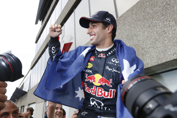 Circuit Gilles Villeneuve, Montreal, Canada. Sunday 8 June 2014. Daniel Ricciardo, Red Bull Racing, 1st Position, celebrates with his team. World Copyright: Alastair Staley/LAT Photographic. ref: Digital Image _79P1325