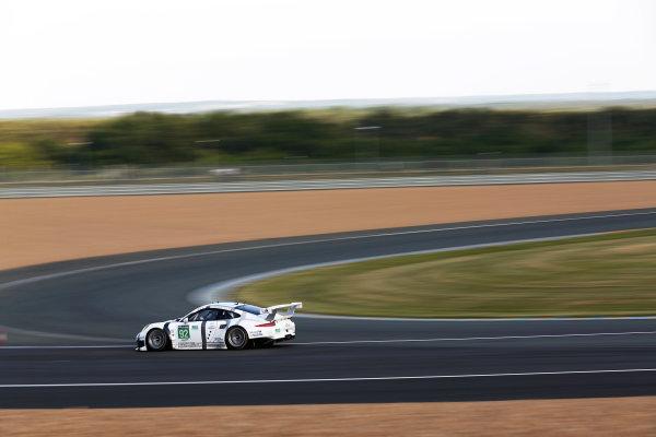 2014 Le Mans 24 Hours. Circuit de la Sarthe, Le Mans, France. Wednesday 11th June, 2014. Marco Holzer (DEU), Frederic Makowiecki (FRA), Richard Lietz (AUT) - Porsche Team Manthey, Porsche 911 RSR  Photo: Sam Bloxham/LAT ref: Digital Image _SBL7273