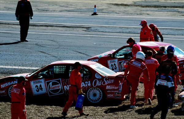 The damaged Nissan Primera eGT of Keith OÕdor (GBR) (Right) and the Nissan Primera eGT of Tiff Needell (GBR) (Left) sit in the gravel trap after their coming together.British Touring Car Championship, Rd 8, Donington Park, England, 12 June 1994.