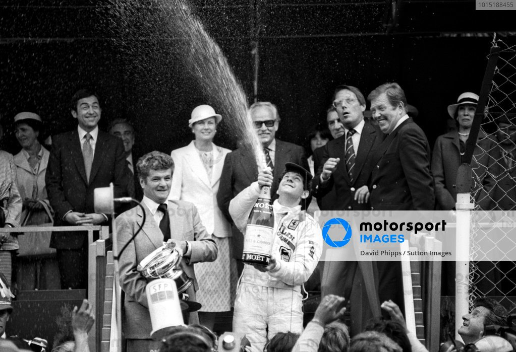 Race winner Jody Scheckter (RSA) celebrates with the champagne on the podium.