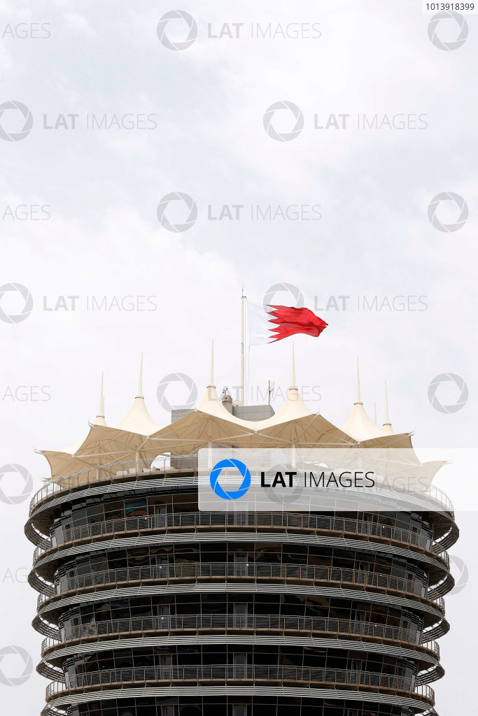 Bahrain International Circuit, Sakhir, Bahrain Thursday 18th April 2013 The Bahrain flag flies at the top of one of the Sakhir circuits buildings. World Copyright: Charles Coates/LAT Photographic ref: Digital Image _N7T7953