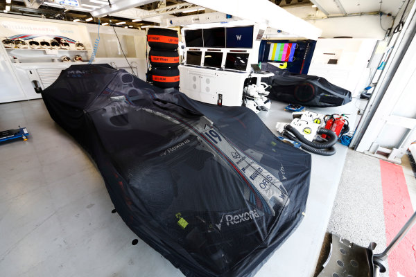Baku City Circuit, Baku, Azerbaijan. Sunday 25 June 2017. The Felipe Massa, Williams FW40 Mercedes, and sister car of Lance Stroll, Williams Martini Racing, under covers in the team's garage. World Copyright: Glenn Dunbar/LAT Images ref: Digital Image _31I1794
