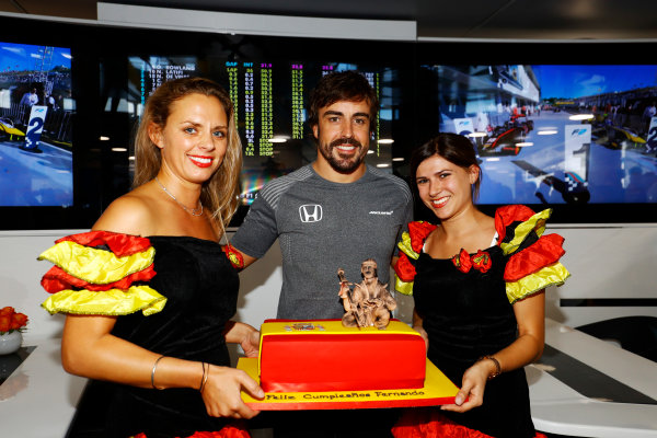 Hungaroring, Budapest, Hungary.  Saturday 29 July 2017. Fernando Alonso, McLaren, celebrates his 36th birthday with a cake.. World Copyright: Steven Tee/LAT Images  ref: Digital Image _R3I3597