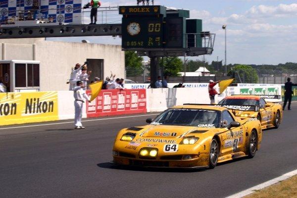 Oliver Gavin (GBR) / Olivier Beretta (FRA) / Jan Magnussen (DEN) Corvette Racing Chevrolet Corvette C5-R cross the line to win GTS.Le Mans 24 Hours, Le Mans, France, 12-13 June 2004.DIGITAL IMAGE