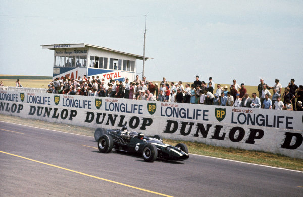 Reims, France.  1-3 July 1966.  Jochen Rindt (Cooper T81-Maserati), 4th position passes Graham Hill (B.R.M. P261), retired, action.  World Copyright: LAT Photographic. Ref: 66FRA06.