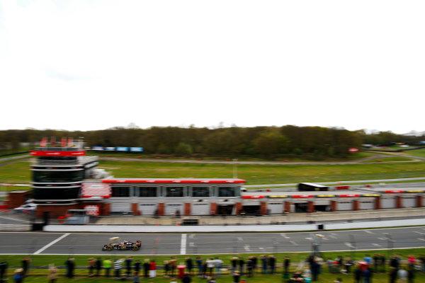 Brands Hatch, Kent, UK. Monday 27 April 2015. Romain Grosjean, Lotus E23 Mercedes passes the pits on the start/finish line. World Copyright: Glenn Dunbar/LAT Photographic. ref: Digital Image _W2Q0444