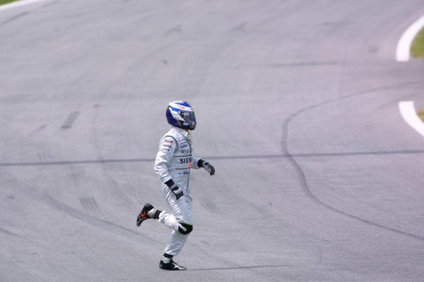 2002 Austrian Grand Prix - Race. A-1 Ring, Zeltweg, Austria. 12th May 2002 Kimi Raikkonen, West McLaren Mercedes MP4/17, crosses the track after retiring from the race. World Copyright: PicMe/LAT ref: Digital Image Only