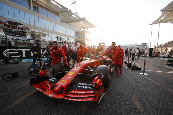 Sebastian Vettel, Ferrari SF90, arrives on the grid with his mechanics