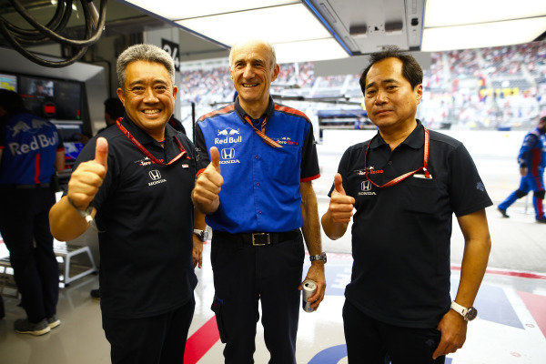 Franz Tost, Team Principal, Toro Rosso, and Toyoharu Tanabe, F1 Technical Director, Honda, celebrate both Toro Rosso's qualifying in the top-ten.