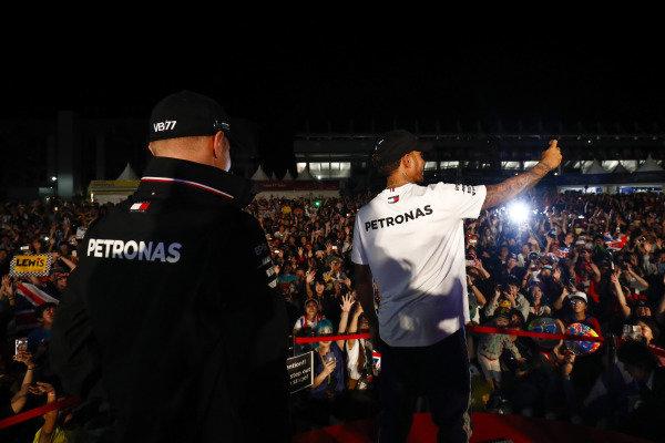 Valtteri Bottas, Mercedes AMG F1, and Lewis Hamilton, Mercedes AMG F1, on stage
