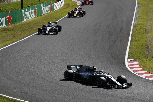 Lewis Hamilton, Mercedes AMG F1 W09 EQ Power+, leads Valtteri Bottas, Mercedes AMG F1 W09 EQ Power+, and Sebastian Vettel, Ferrari SF71H