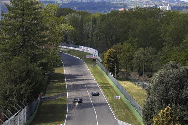 Nicholas Latifi, Williams FW43B, leads Lance Stroll, Aston Martin AMR21, as sparks trail behind