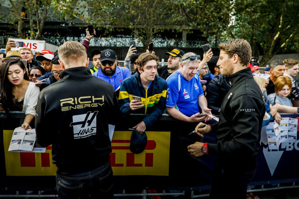 Kevin Magnussen, Haas F1 Team Romain Grosjean, Haas F1 Team sign autographs for fans at the Federation Square event.