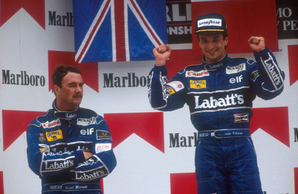 1991 Mexican Grand Prix.Mexico City, Mexico.14-16 June 1991.Riccardo Patrese celebrates 1st position with teammate Nigel Mansell, 2nd position on the podium (both Williams Renault). Ref-91 MEX 07.World Copyright - LAT Photographic