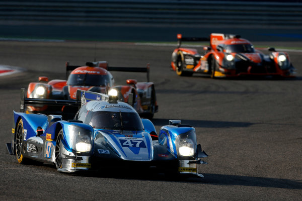 2015 FIA World Endurance Championship Bahrain 6-Hours Bahrain International Circuit, Bahrain Saturday 21 November 2015. Matthew Howson, Richard Bradley, Nick Tandy (#47 LMP2 KCMG Oreca 05 Nissan) leads Roman Rusinov, Julien Canal, Sam Bird (#26 LMP2 G-Drive Racing Ligier JS P2 Nissan) and Gustavo Yacaman, Luis Felipe Derani, Ricardo Gonzalez (#28 LMP2 G-Drive Racing Ligier JS P2 Nissan). World Copyright: Alastair Staley/LAT Photographic ref: Digital Image _79P0179