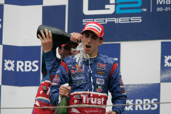 Magny-Cours, France. 22nd June.Sunday Race. Sebastien Buemi (SUI, Trust Team Arden) celebrates his victory on the podium with Yelmer Buurman (NED, Trust Team Arden). World Copyright: Alastair Staley/GP2 Series Media Service.ref: Digital Image _MG_3569