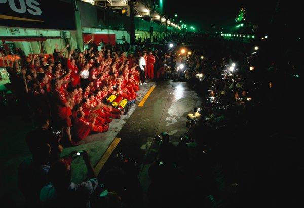 2003 Japanese Grand PrixSuzuka, Japan. 10th - 112th October 2003.Ferrari team celebrate 2003 Formula One World Championship.World Copyright: Charles Coates / LAT Photographic ref: 35mm Image 03JAP20