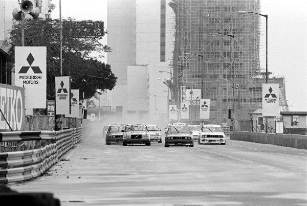 A BMW M3 leads the field at the start of the race.Macau Guia Race for Touring Cars, Macau, Hong Kong, 30 November 1987.