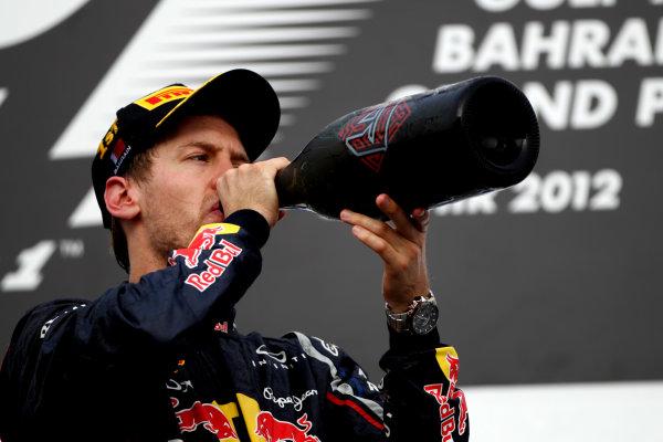 Bahrain International Circuit, Sakhir, Bahrain22nd April 2012Sebastian Vettel, Red Bull Racing, 1st position, downs the Waard.World Copyright: Andy Hone/LAT Photographicref: Digital Image HONY8742