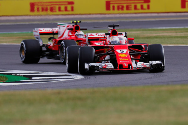 Silverstone, Northamptonshire, UK.  Friday 14 July 2017. Sebastian Vettel, Ferrari SF70H, runs with the Shield frontal protection system fitted, ahead of Kimi Raikkonen, Ferrari SF70H. World Copyright: Zak Mauger/LAT Images  ref: Digital Image _56I8176