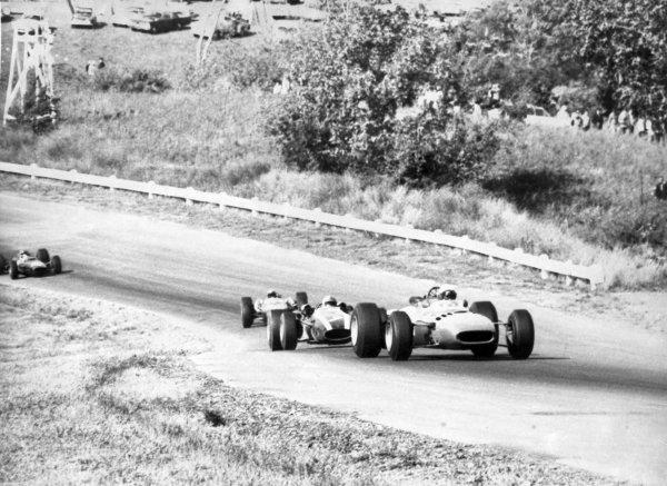1966 United States Grand Prix.Watkins Glen, New York, USA.30/9-2/10 1966.Lorenzo Bandini (Ferrari 312), retired, leads John Surtees (Cooper T81), 3rd position, action.Ref-B/W PrintWorld Copyright - LAT Photographic