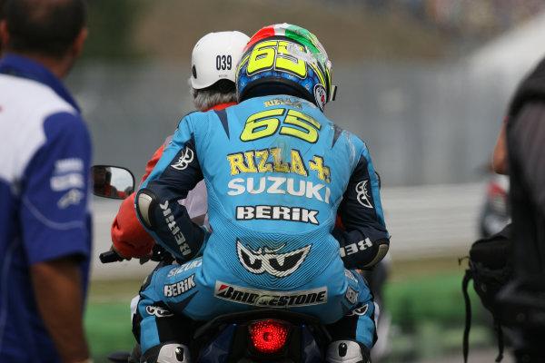 San Marino Misano 03-05 September 2010Loris Capirossi Rizla Suzuki is driven away on a scooter after his crash