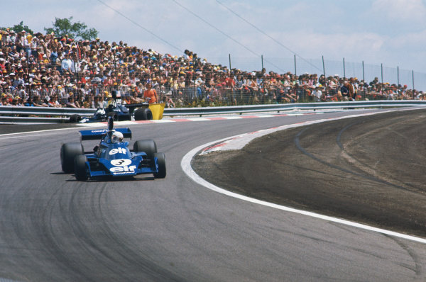 1974 French Grand Prix  Dijon-Prenois, France. 5-7th July 1974.  Jody Scheckter, Tyrrell 007 Ford, drifts down the hill past Tom Pryce's retired Shadow DN3 Ford.  Ref: 74FRA04. World Copyright: LAT Photographic