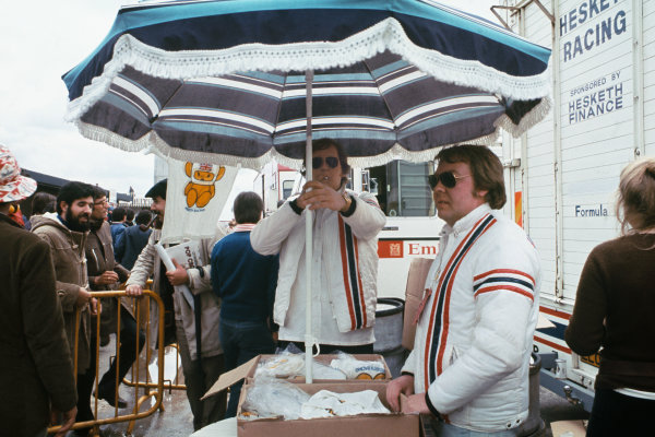 1974 Spanish Grand Prix.  Jarama, Madrid, Spain. 26-28th April 1974.  Anthony (Bubbles) Horsley, with Hesketh Racing merchandise in the paddock.  Ref: 74ESP23. World Copyright: LAT Photographic