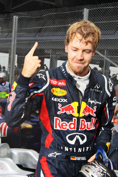 World Champion Sebastian Vettel (GER) Red Bull Racing celebrates in parc ferme. Formula One World Championship, Rd20 Brazilian Grand Prix, Race, Sao Paulo, Brazil, 25 November 2012.  BEST IMAGE