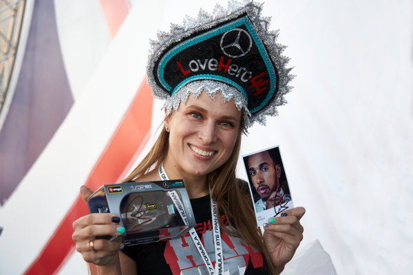 Sochi Autodrom, Sochi, Russia. Thursday 27 April 2017. A fan of Lewis Hamilton, Mercedes AMG, wearing a novelty hat, proudly displays a signed model and autograph card. World Copyright: Steve Etherington/LAT Images ref: Digital Image SNE16135