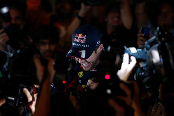 Buddh International Circuit, New Delhi, India. Sunday 27th October 2013. Sebastian Vettel, Red Bull Racing, 1st position, celebrates securing his fourth drivers title. World Copyright: Glenn Dunbar/LAT Photographic. ref: Digital Image _89P9322
