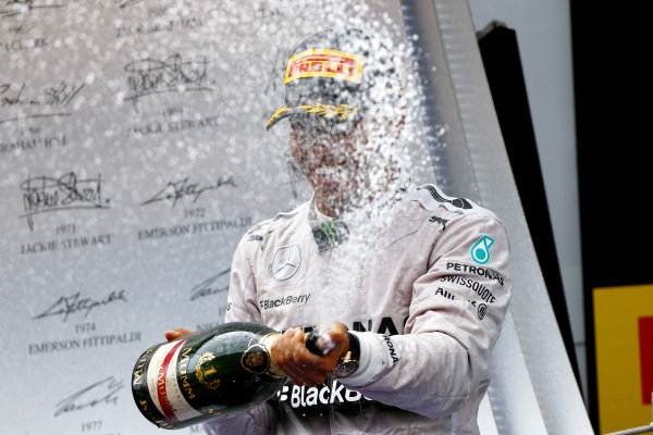 Circuit de Catalunya, Barcelona, Spain. Sunday 11 May 2014. Lewis Hamilton, Mercedes AMG, 1st Position, sprays the victory Champagne. World Copyright: Andy Hone/LAT Photographic. ref: Digital Image _ONY2256