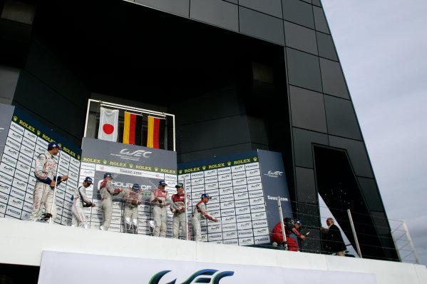 Silverstone, England. 24th - 26th August 2012. Rd 4.Alexander Wurz (AUT), Nicolas Lapierre (FRA), Kazuki Nakajima (JPN), Toyota Racing, Toyota TS030 Hybrid, Andre Lotterer (GER), Marcel Fassler (CHE), Benoit Treluyer (FRA), Audi Sport Team Joest, Audi R18 E-Tron Quatrro, Tom Kristensen (DNK), Allan McNish (GBR), Audi Sport Team Joest, Audi R18 Ultra, celebrate, Podium, Portrait, World Copyright: Chris Bird/LAT Photographic.Ref:  _A1A0884