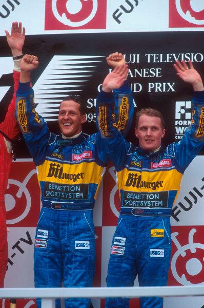 Suzuka, Japan.27-29 October 1995.Michael Schumacher, 1st position with teammate Johnny Herbert, (both Benetton Renault's) 3rd position on the podium.Ref-95 JAP 05.World Copyright - LAT Photographic