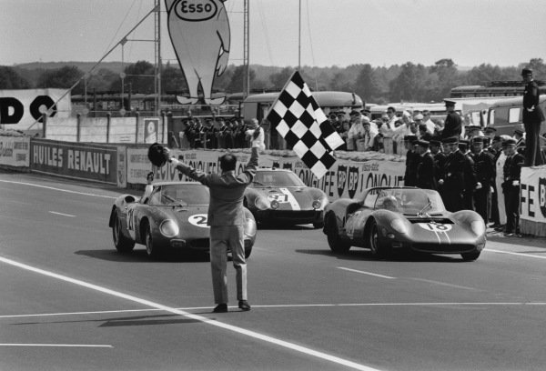 Le Mans, France. 19th - 20th June 1965 Jochen Rindt/Masten Gregory (Ferrari 250 LM), 1st position, leads Nino Vaccarella/Pedro Rodriguez (Ferrari 365 P2/P1), 7th position and Armand Boller/Dieter Spoerry (Ferrari 250 LM), 6th position, across the finishing line, action. World Copyright: LAT PhotographicRef: L65 - 271 - 16.