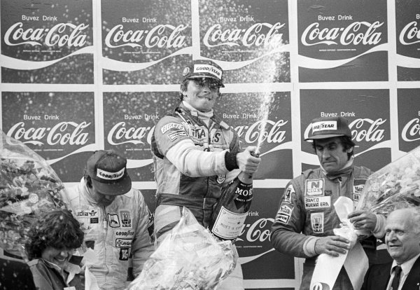 Didier Pironi (FRA) Ligier (Centre) celebrates his first GP win on the podium with second placed Alan Jones (AUS) Williams (Left) and third placed Carlos Reutemann (ARG) Williams (Right).Belgian Grand Prix, Rd 5, Zolder, Belgium, 4 May 1980.
