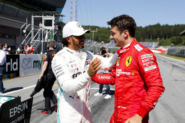 Lewis Hamilton, Mercedes AMG F1 and Pole Sitter Charles Leclerc, Ferrari celebrate in Parc Ferme