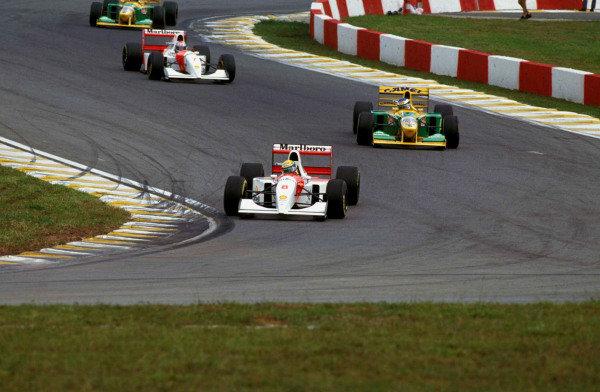 Ayrton Senna, McLaren MP4-8 Ford, leads Michael Schumacher, Benetton B193A Ford, and Michael Andretti, McLaren MP4-8 Ford.