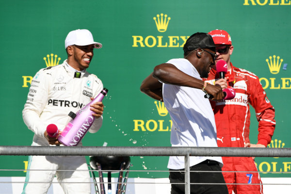 Race winner Lewis Hamilton (GBR) Mercedes AMG F1 celebrates on the podium with the champagne and Usain Bolt (JAM) and Kimi Raikkonen (FIN) Ferrari at Formula One World Championship, Rd17, United States Grand Prix, Race, Circuit of the Americas, Austin, Texas, USA, Sunday 22 October 2017.