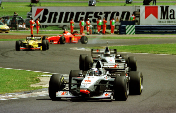 1997 British Grand Prix.Silverstone, England.11-13 July 1997.David Coulthard leads Mika Hakkinen (both McLaren MP4/12 Mercedes-Benz) early in the race at Vale.World Copyright - Winter/LAT Photographic