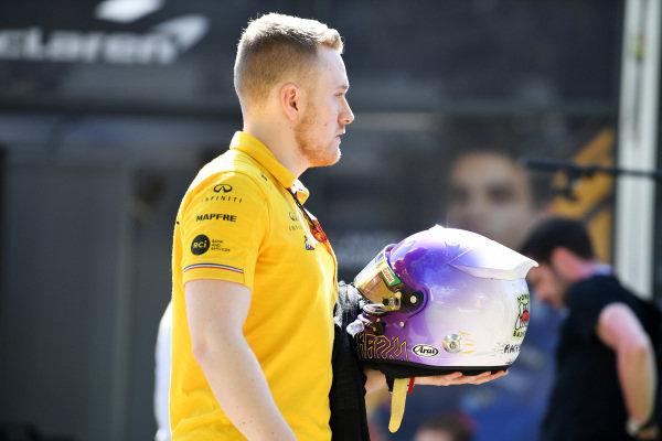 A member of the Renault team with Daniel Ricciardo's helmet