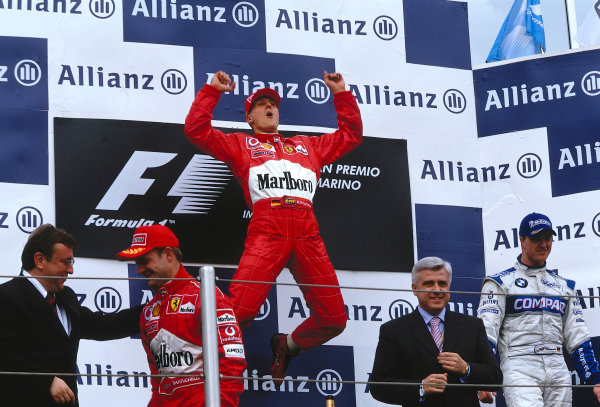 2002 San Marino Grand Prix. Imola, Italy. 12-14 April 2002. Michael Schumacher (Ferrari) celebrates his 1st position, Rubens Barrichello (Ferrari) 2nd position and Ralf Schumacher (Williams BMW) 3rd position also on the podium.  Ref-02 SM 24. World Copyright - LAT Photographic