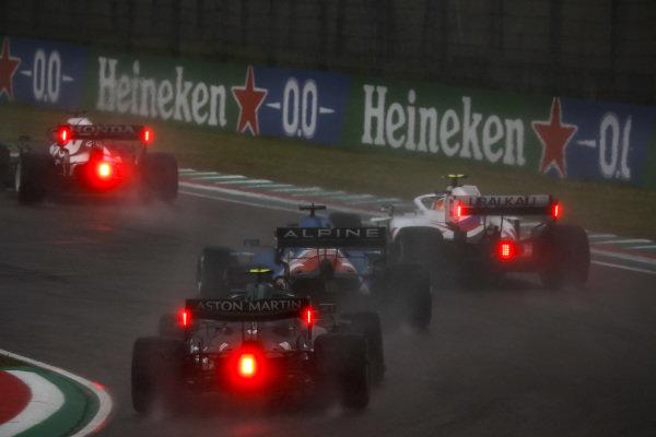 Yuki Tsunoda, AlphaTauri AT02, leads Mick Schumacher, Haas VF-21, Fernando Alonso, Alpine A521, and Sebastian Vettel, Aston Martin AMR21